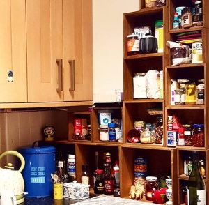 New very very tiny kitchen, so I made cupboard space by precariously stacking boxes up one wall. Oooooh...